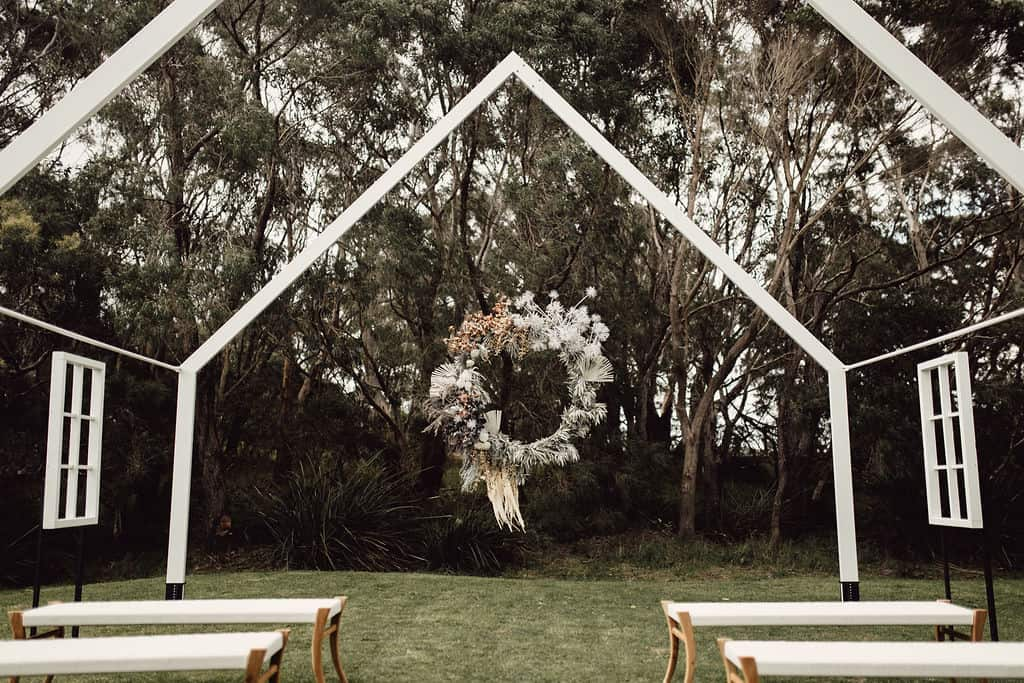 The couple brought in Stylist Brodie from the Bib Approach and floral stylist Lara Rose Bos, who dreamt up and created floralscapes of epic proportions made from dried native florals, branches, bleached ferns and seed pods